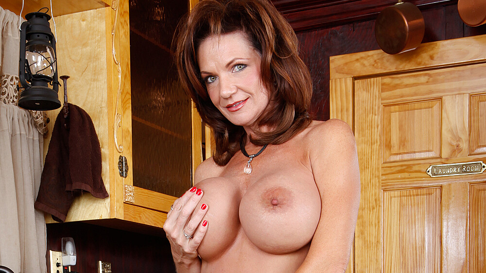 Deauxma fucking in the kitchen with her big tits